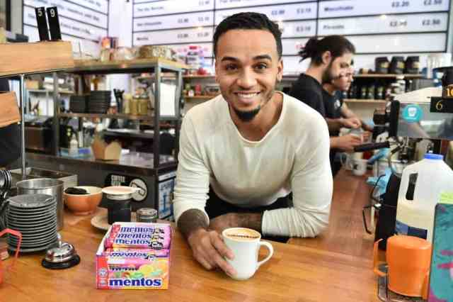 Strictly Come Dancing contestant Aston Merrygold meets coffee shop customers to celebrate World Hello Day, in association with Mentos, which is on Tuesday November 21, London. PRESS ASSOCIATION Photo. Issue date: Monday November 20, 2017. Photo credit should read:
