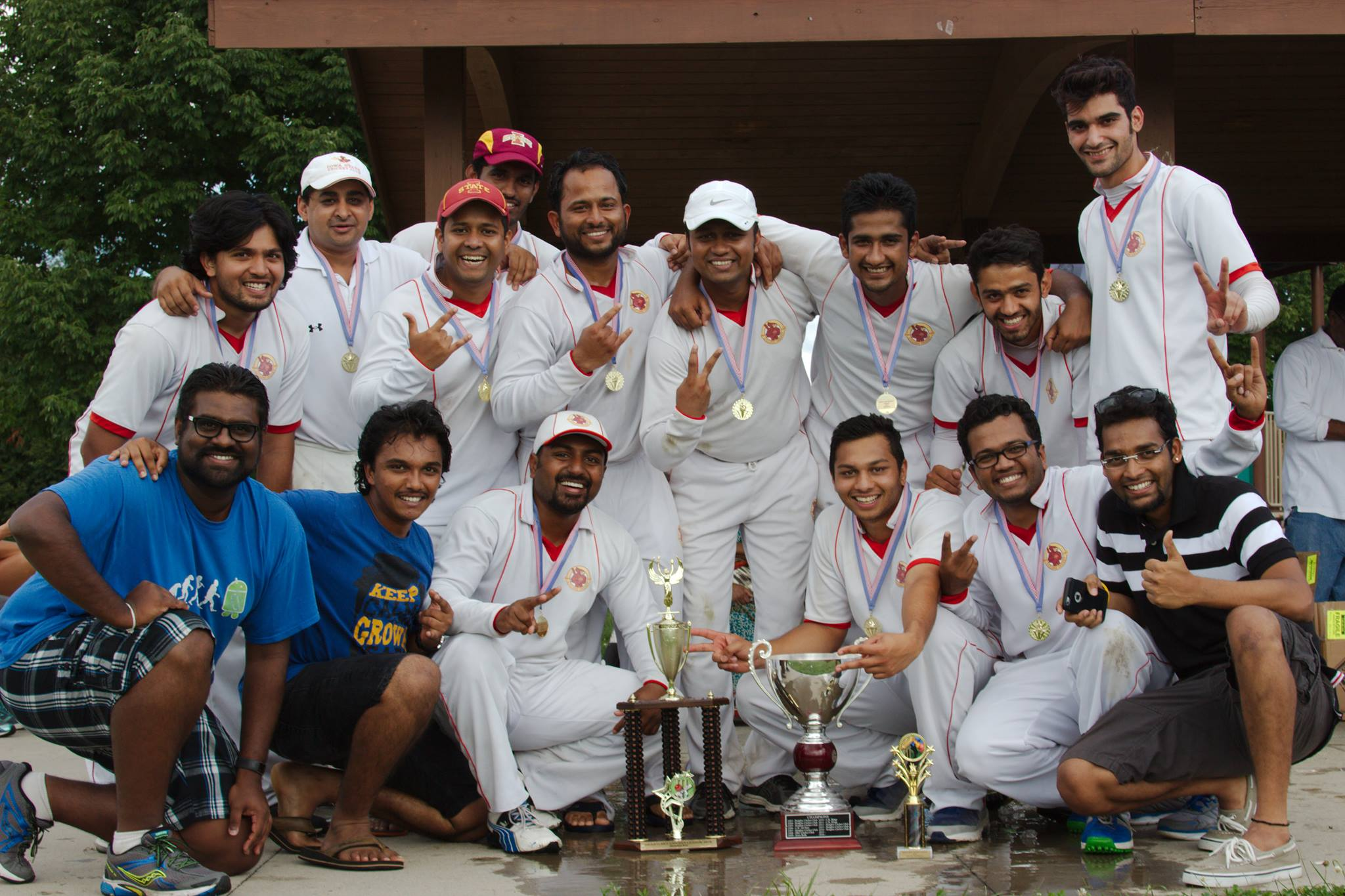 Photo of Avinash and teammates with trophy