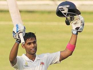 Photo of Suryakumar Yadav raising his bat