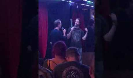 Chris D'Elia and Bryan Callen roasting each other on stage.