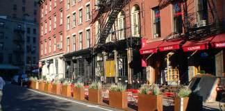 Sidewalk dining space created from parking (Broken Sidewalk)