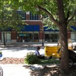 Reading a book during Park(ing) Day on Fourth Street. (Branden Klayko)