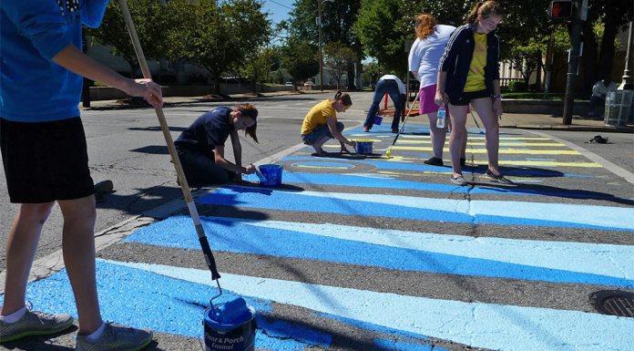 Volunteers paint colorful crosswalks along Fourth Street in SoBro.