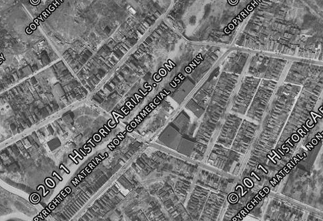 Aerial photograph of the site from 1949 showing a cluster of warehouses along Mellwood and Frankfort avenues. (Courtesy Historic Aerials)