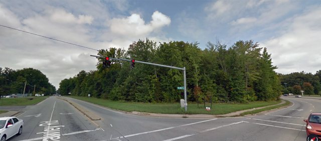 The heavily-wooded library site. (Courtesy Google)