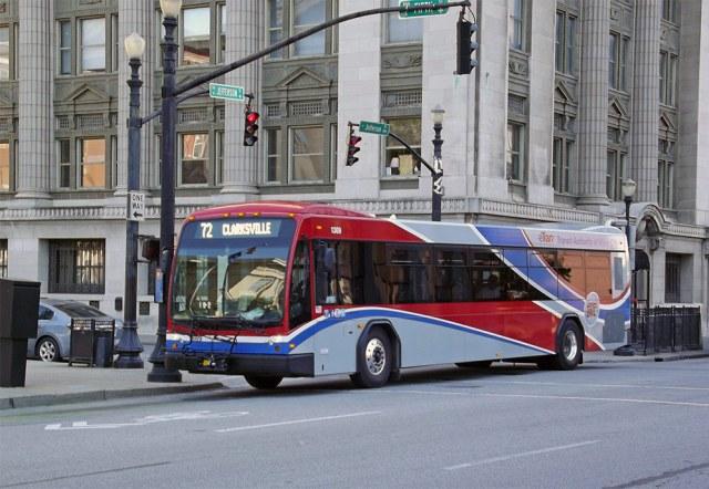 A modern TARC bus runs along Jefferson Street. (Darius Pinkston / Flickr)