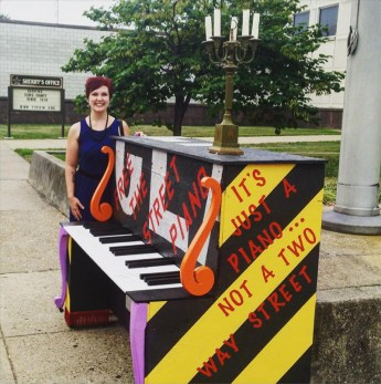 Rosenberry stands next to the protest piano. (Courtesy Rosenberry)