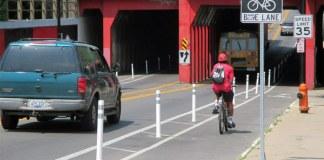 A buffered bike lane with bollards on Fourth Street near the University of Louisville. (Courtesy Bike Louisville)
