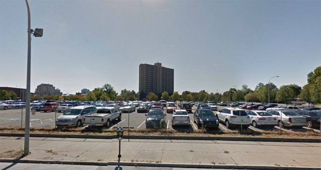 LMHA is spending $150,000 to repave a parking lot at Avenue Plaza, the high rise pictured, located in a part of Downtown replete with parking lots. (Courtesy Google)