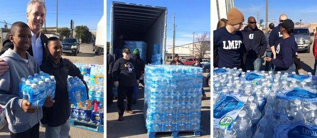 Mayor Fischer and community members load water to be shipped to Flint, Michigan. (Courtesy Office of the Mayor)
