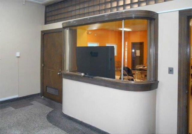 A curved glass window in the lobby of the Administration Building. (Courtesy NPS)
