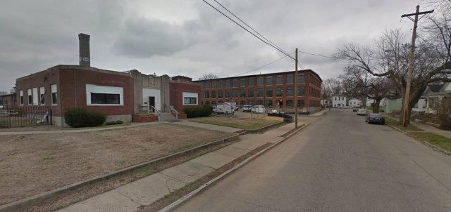 Looking north on McHenry toward Goss Avenue with the larger mill building behind the Administration Building. (Courtesy Google)