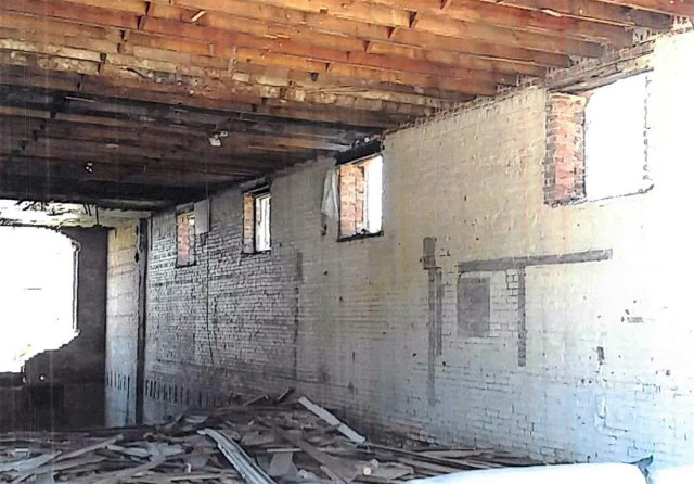 Floor joists in the back of the first floor have been removed. Similar moves have resulted in major structural damage in other buildings around the city. (Courtesy Metro Louisville)