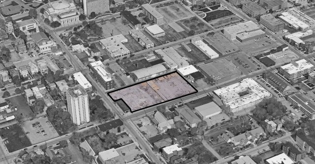 The parking lot site in the larger neighborhood context. (Via Google)