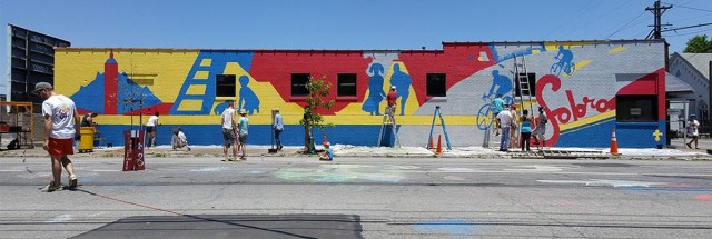 Community members paint a mural at Second and Kentucky streets. (Courtesy SoBro Louisville / Facebook)