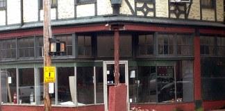 Damage from a motorist hitting a building in Old Louisville. (Branden Klayko / Broken Sidewalk)