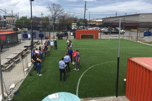 UK landscape architecture students at the ReSurfaced soccer pitch. (Patrick Piuma)