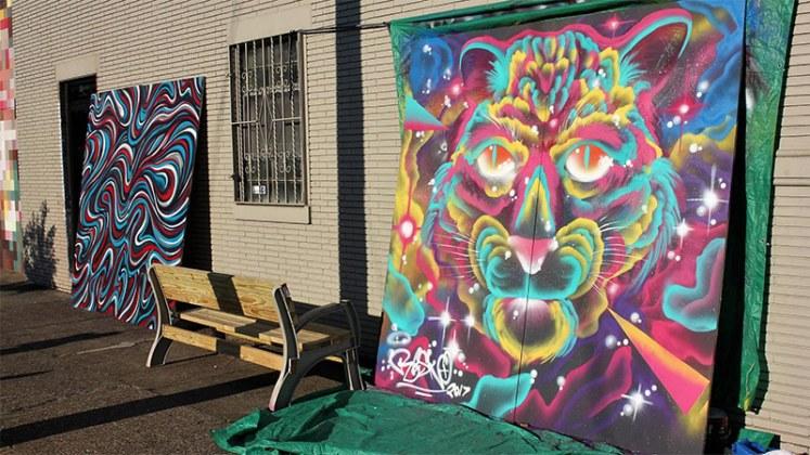 Two artworks created during Better Block. (Courtesy Center for Neighborhoods)