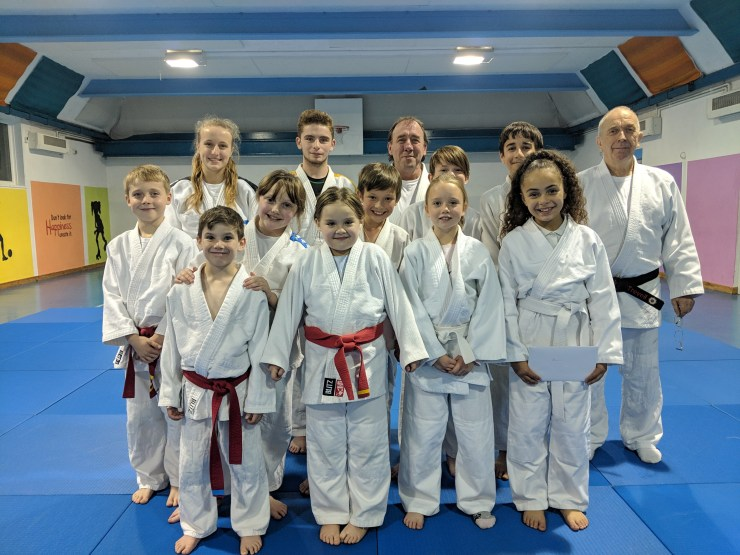 The judoka from Bromley Judo Academy's second mat standing with the coaches
