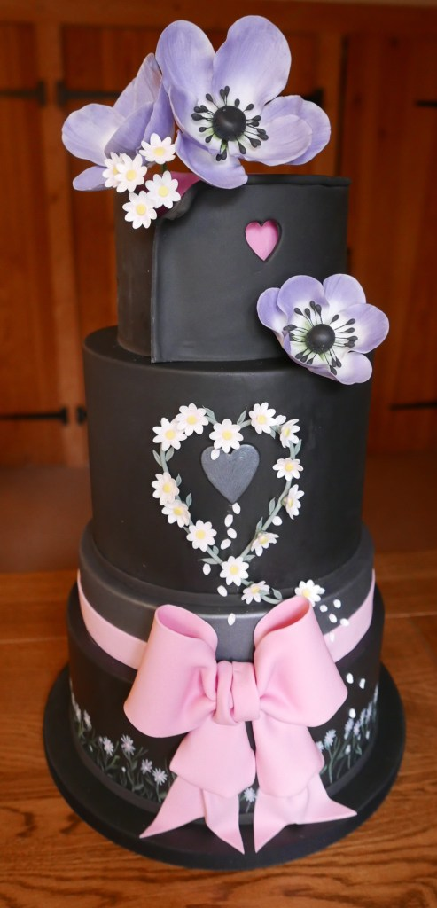 gallery Black Wedding Cake with pink bow
