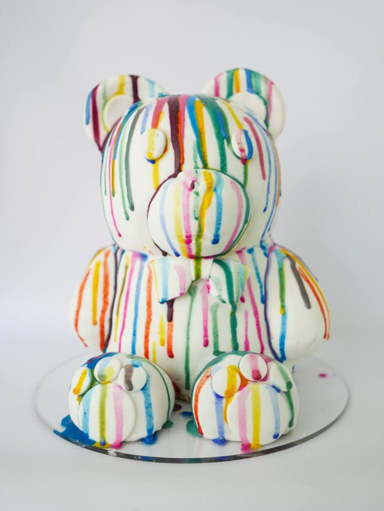 teddy bear sculpted cake with paint drips art cake