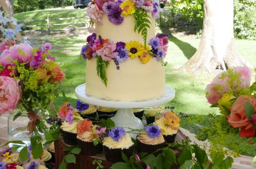 Edible flower 3 tier wedding cake with cupcakes