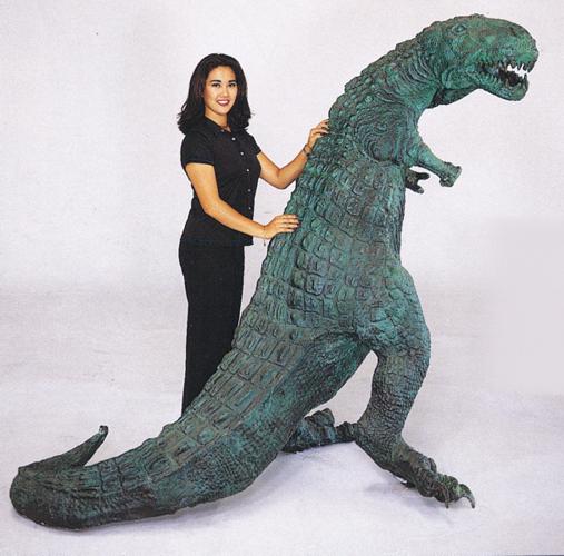 bronze dinosaur statue