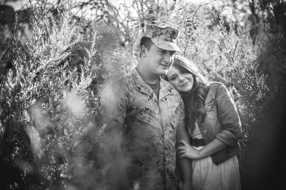 Military couple in desert foliage