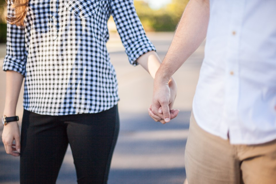 engagement picture of couple holding hands