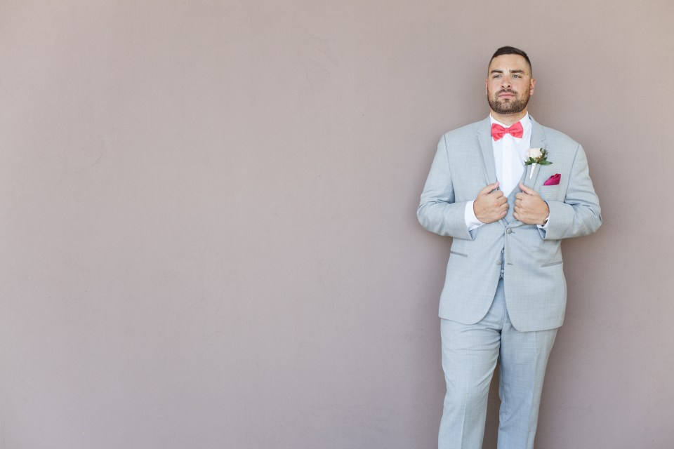 groom's tux, grey suit with red bowtie