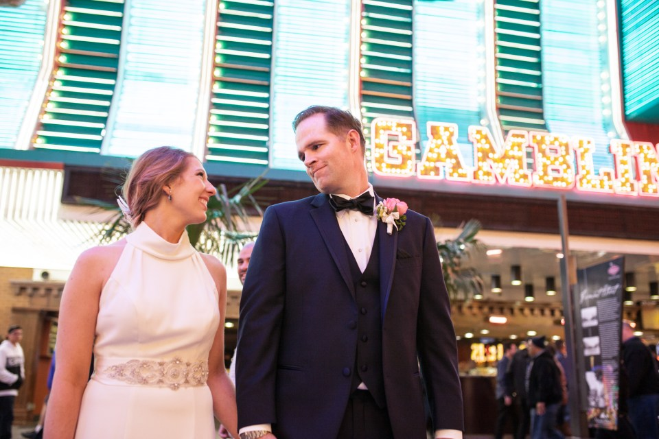vegas wedding bride and groom with vegas lights