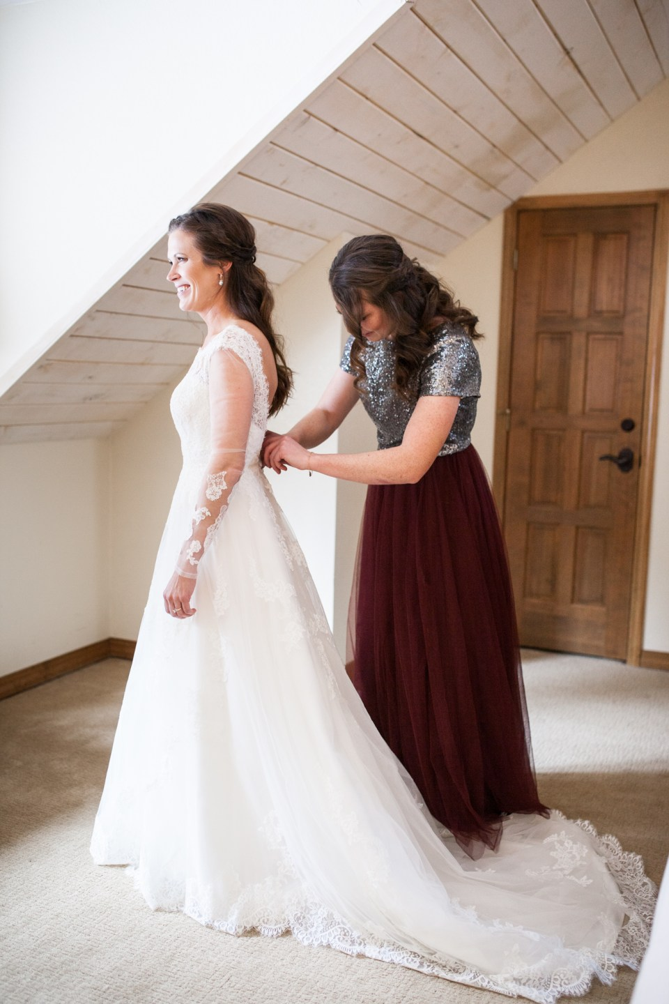 getting ready pictures with long sleeve wedding dress