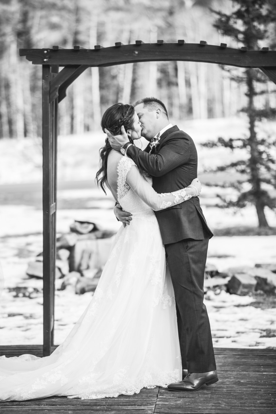 Durango, Colorado Winter Wedding ceremony first kiss as husband and wife, winter bride and groom