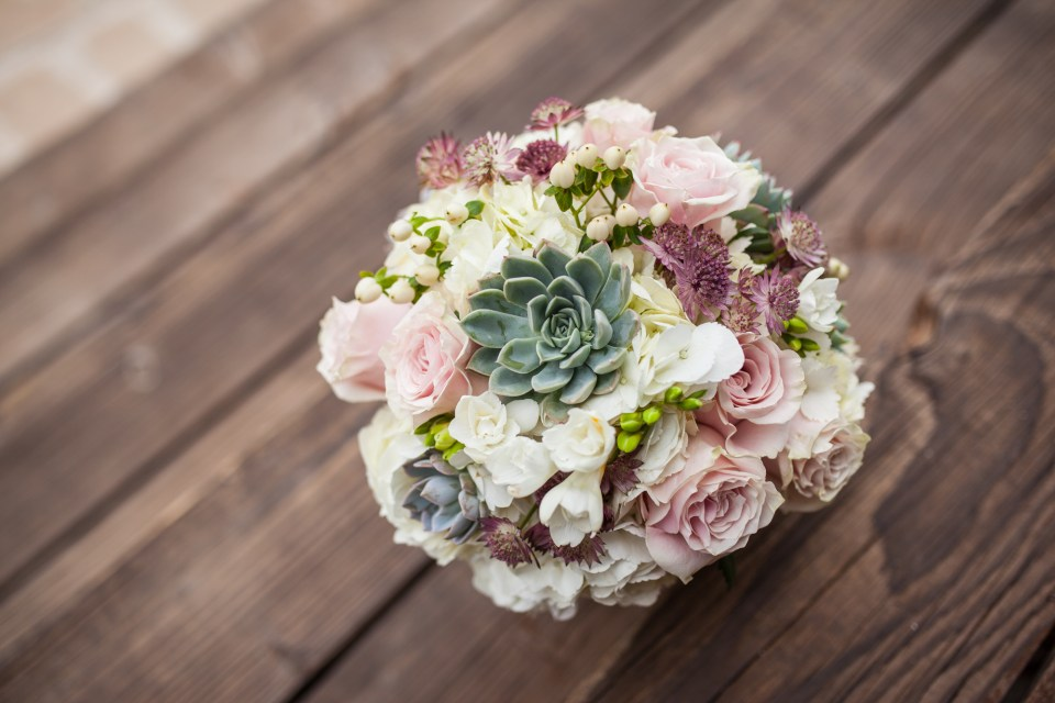 succulent wedding bouquet with pink roses