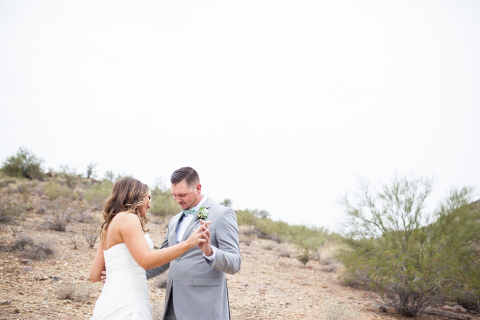 bride and groom first look rainy phoenix desert wedding