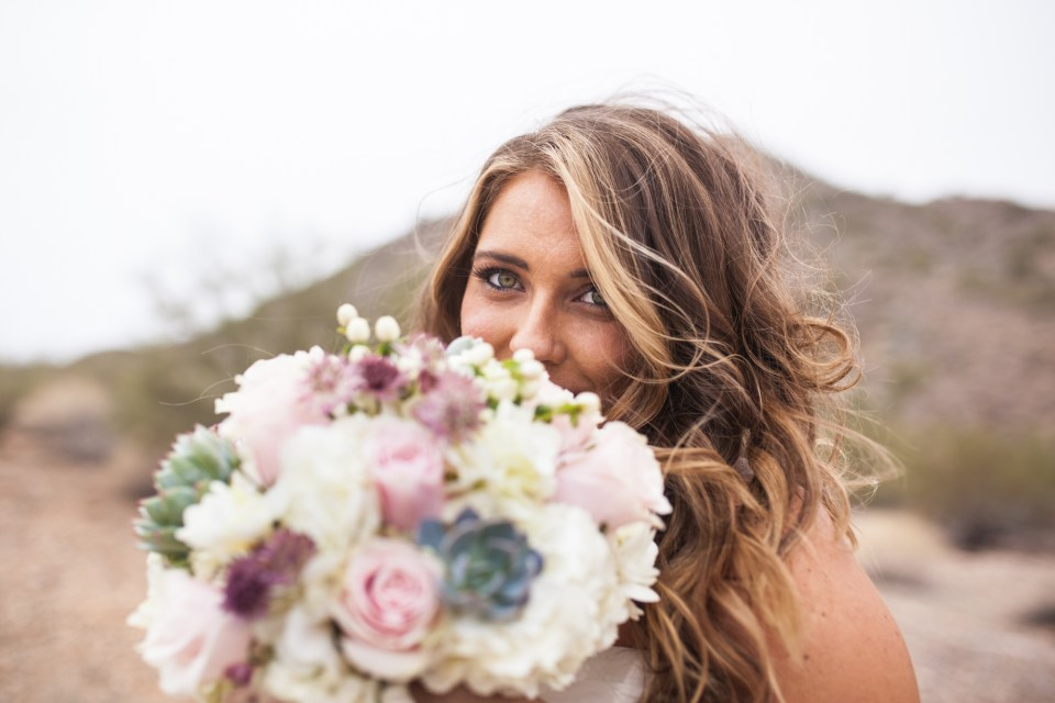 bride with succulent bridal bouquet with pink roses