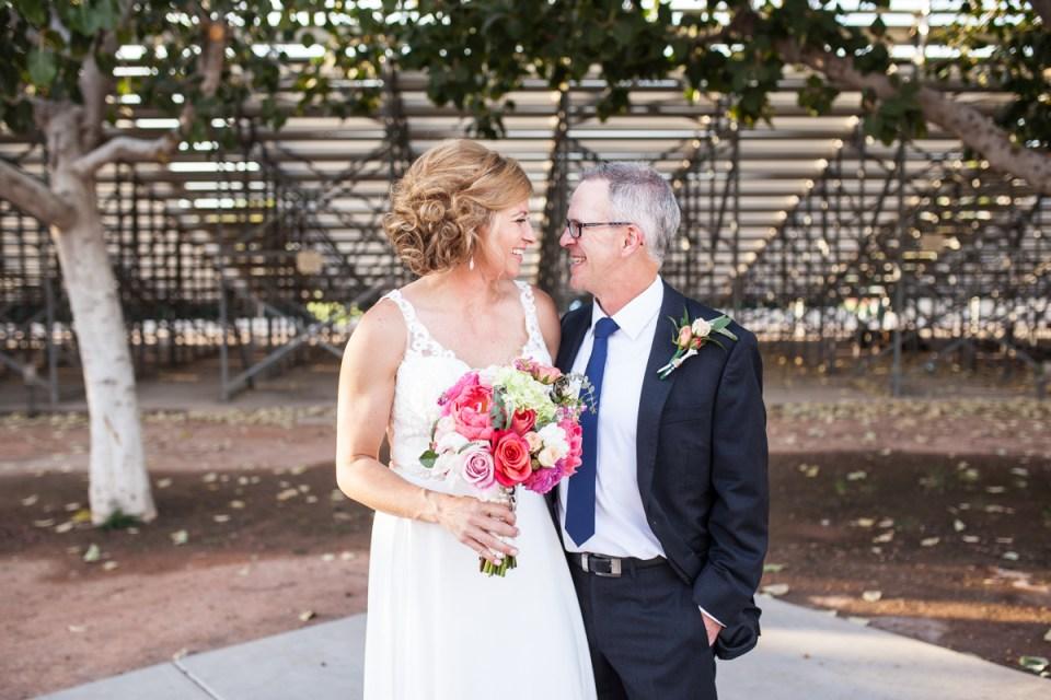 bride and groom on wedding day scottsdale Arizona wedding baseball stadium wedding
