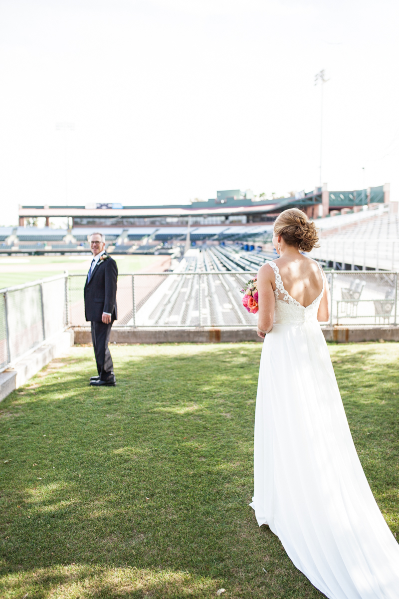 first look with bride and groom in baseball stadium
