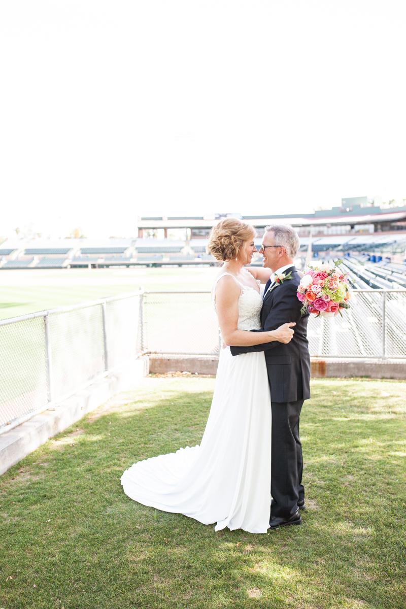 bride and groom in baseball stadium scottsdale arizona wedding