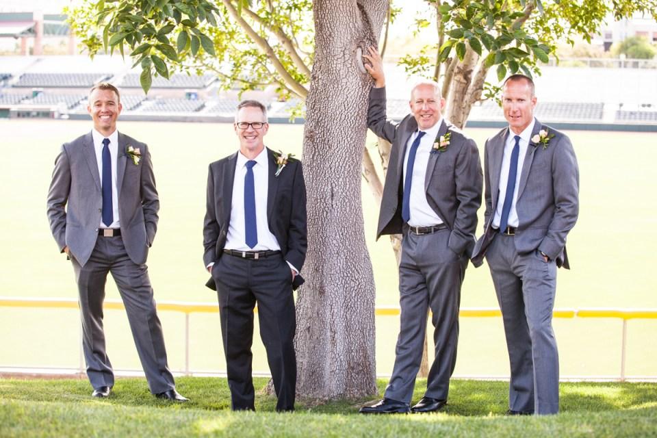 groom and groomsmen at baseball stadium wedding