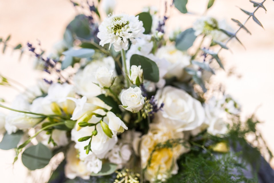 large bridal bouquet with greenery and white flowers