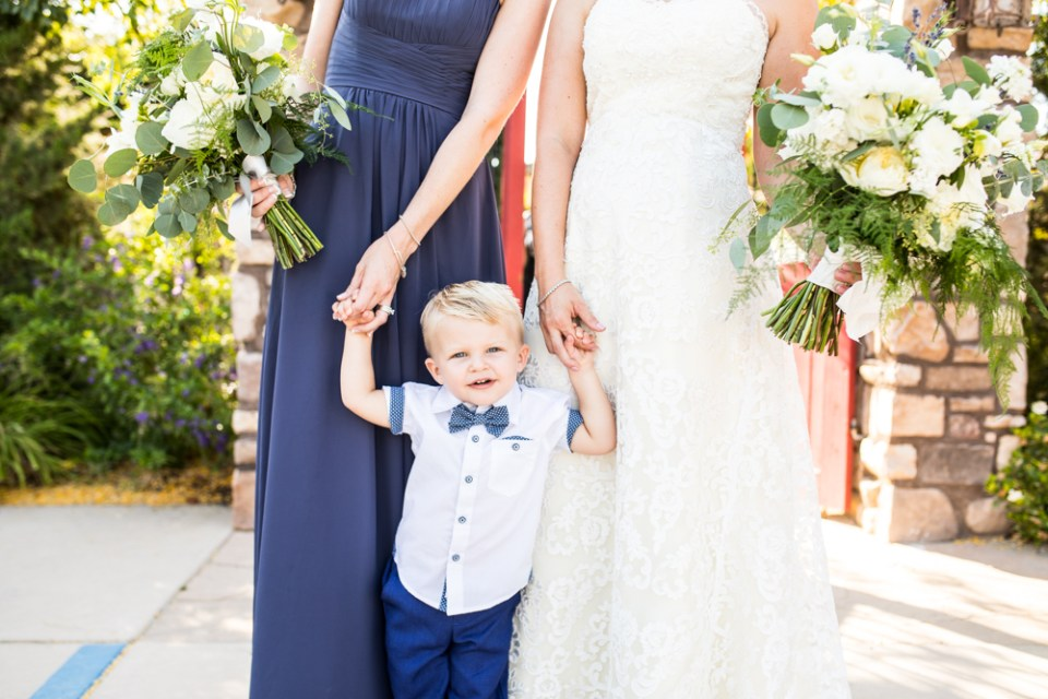 bride and bridesmaid with little ring bearer boy