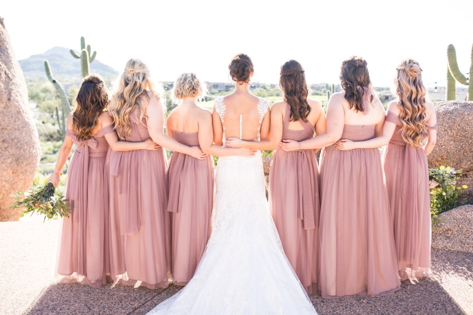 Bride and blush bridesmaids desert wedding