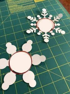 Snowflakes with pictures in middle