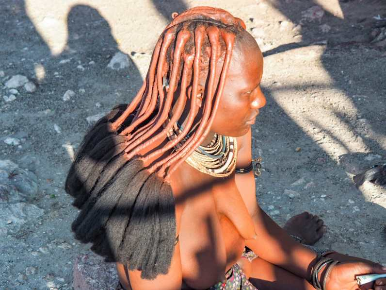Himba woman selling bracelets in northern Namibia