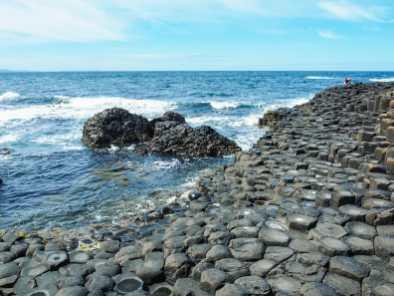 Basalt columns descending into the sea