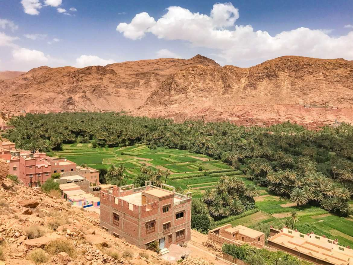 View over green fields and mountains Sahara Desert Tour Morocco
