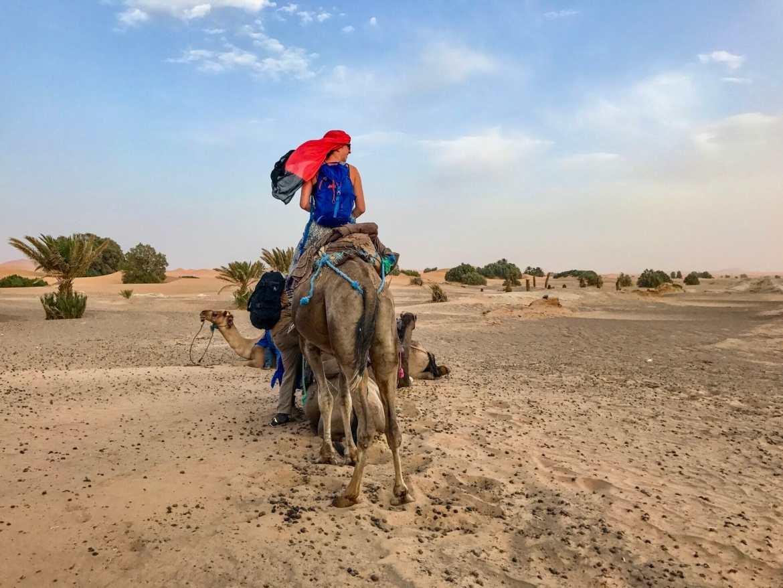 Girl riding camel in Sahara Desert Morocco