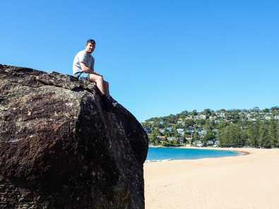 Callum atop the bouldering rocks at Palm Beach
