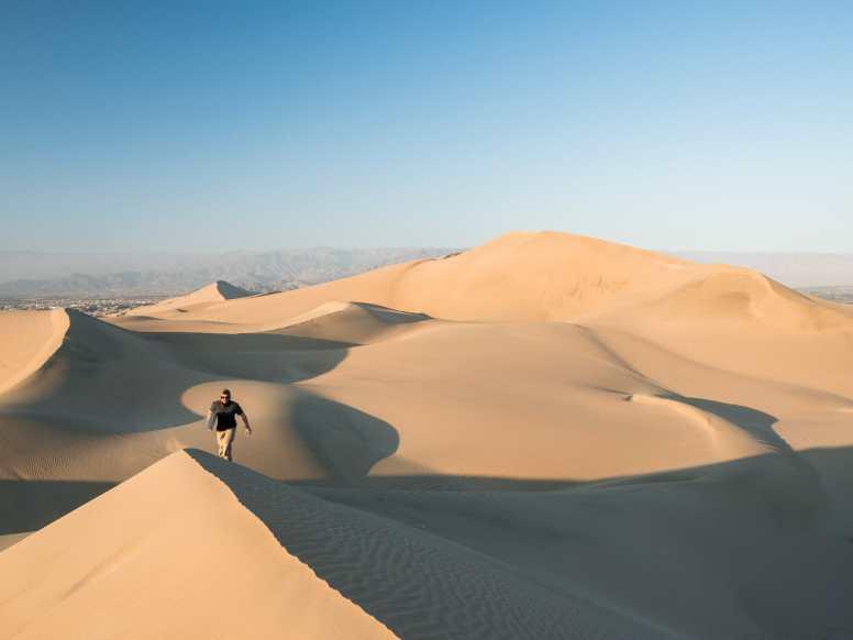 Climbing up the Huacachina sand dunes
